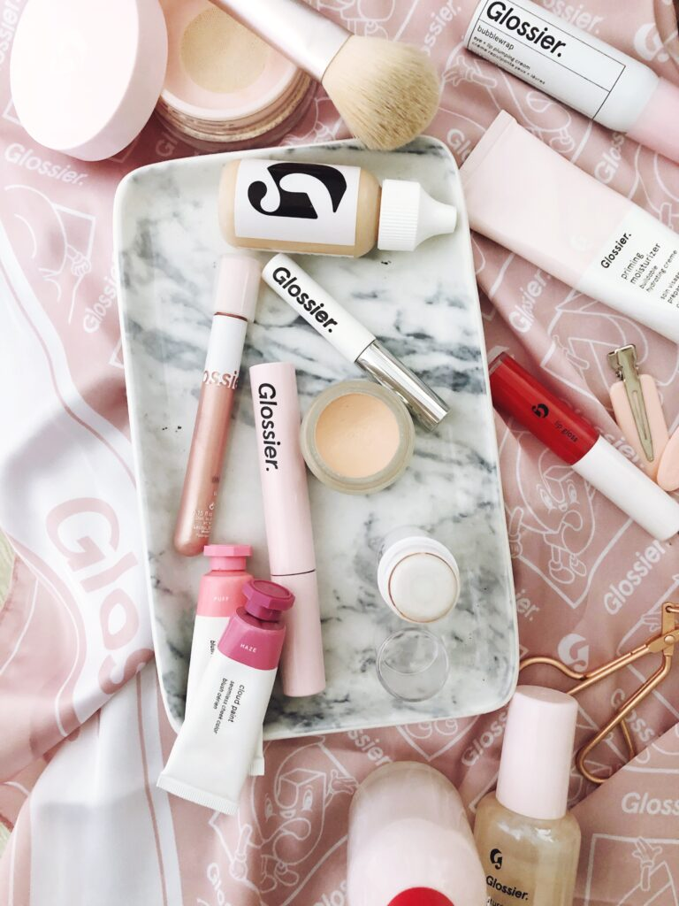 Glossier makeup flat lay